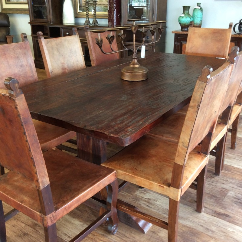 This handsome dining room set is both rustic and farm-housy looking. The hand planed table features solid wood construction and a dark walnut finish. The 8 chairs features sold wood frames and real leather seats and backs. They're quite comfortable, too!