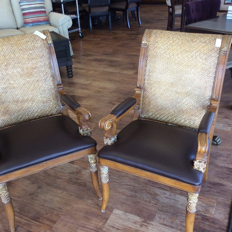 These HOOKER chairs look barely used. They feature solid wood construction with a pretty antiqued maple finish. The seat backs are woven in a herring bone pattern. The seats and arms are covered in genuine leather. The pretty carved details set these apart from their peers.