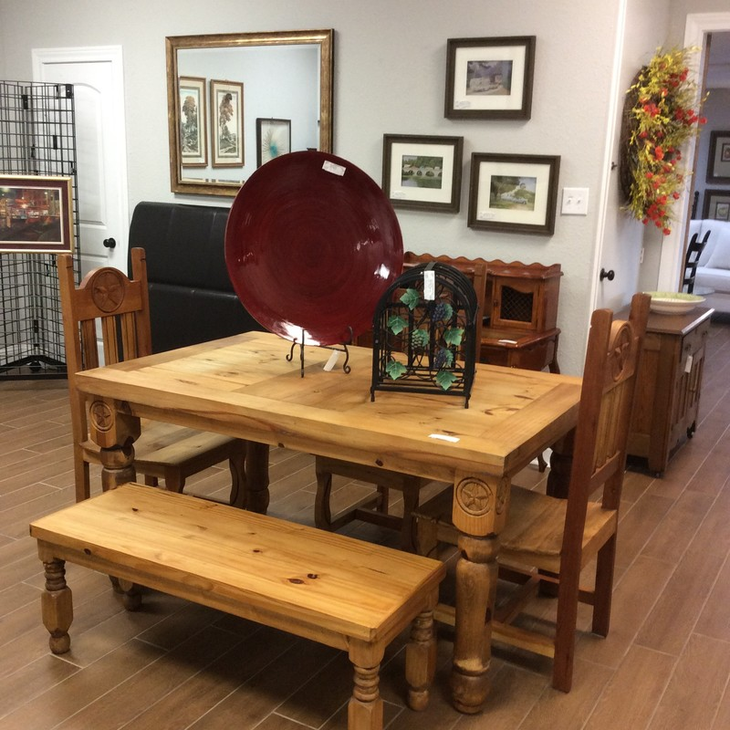 BARGAIN ALERT! This dining room set has been priced low! Constructed of knotty pine and rustic in style it features 3 roomy chairs and a bench. The Texas Lone Star has been carved into the table and chairs. Perfect condition!