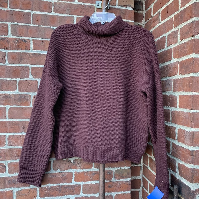 Lovely, thick-knit turtleneck sweater from Vince. The dark maroon/plum color is the perfect shade for winter weather. Size medium. In good condition.
