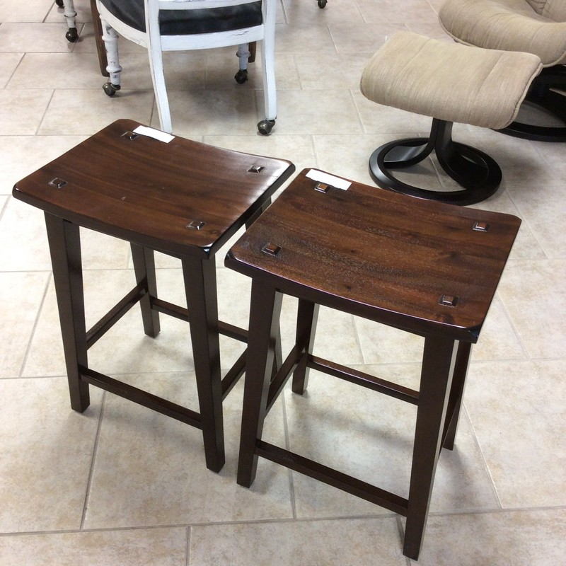 This is a great pair of small barstools! From Pier 1 originally, they feature a rich, dark wood finish and are a little rustic in style with simple, clean lines. Very handsome and priced well!