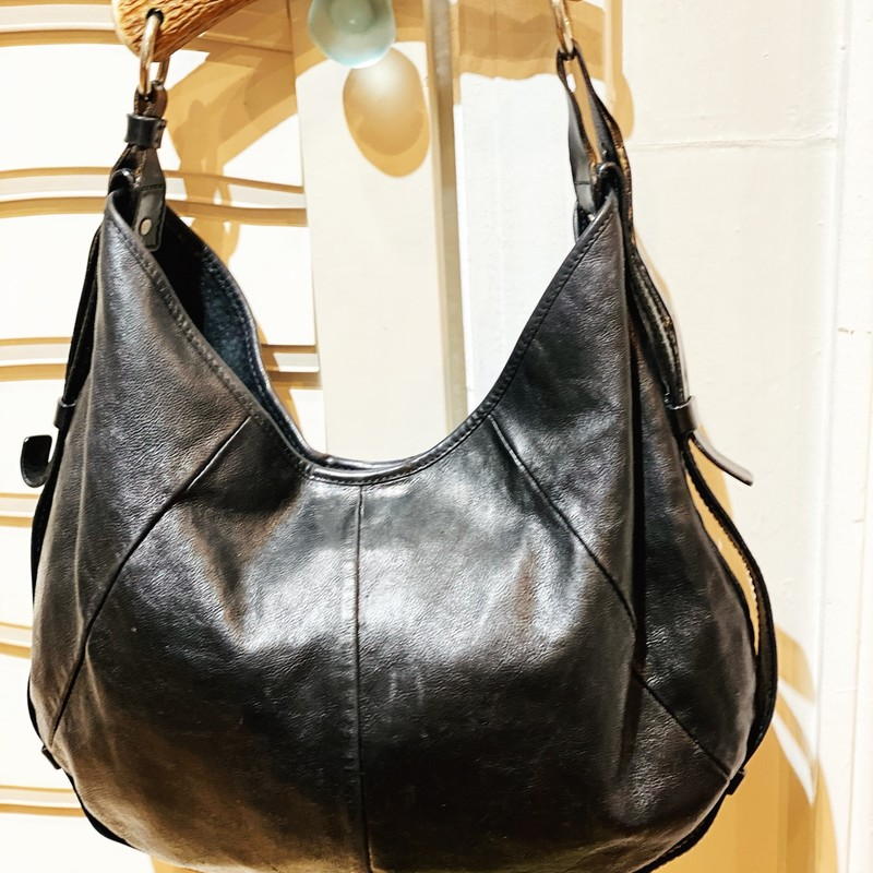 "Lambskin, black leather handbag from Yves Saint Laurent with horn handle. Features inside zipper pocket and magnetic button closure. The strap is adjustable. The inside is slightly used -- please refer to pictures. 14""L x 3.5""W x 7.5""H"