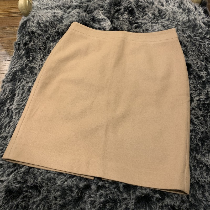 JCrew The Pencil Skirt<br /> Size: 10<br /> Color:Camel<br /> Lined Wool Pencil<br /> 70% Wool,30% Viscose<br /> Lining 100%Acetate<br /> Back zip with hook & eye closure<br /> Kick pleat