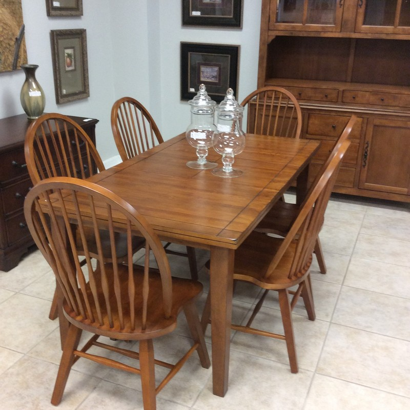 This is a lovely diningroom set! Shaker style,  it is constructed of oak and includes a butterfly leaf. Six chairs are included.Synonymous with simplicity, understated style and craftsmanship, Shaker design is characterized by clean lines that add depth and interest without being visually overpowering. In other words, it's beauty is in it's simplicity.