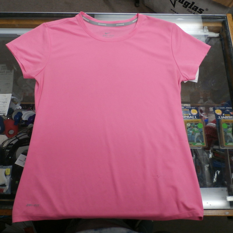 "Nike Women's Dri-fit Short Sleeve Shirt Size Medium Pink #19658<br /> Rating: (see below) 3- Good Condition<br /> Team: N/a<br /> Player: n/a<br /> Brand: Nike<br /> Size: Women's -   Medium (Measured Flat: Across chest 16"", length 24"")<br /> Measured flat: arm pit to arm pit; top of shoulder to the hem<br /> Color: pink<br /> Style:  Short sleeve shirt; screen pressed;<br /> Material: 100%polyester<br /> Condition: 3- Good Condition - wrinkled; minor pilling and fuzz;<br /> Item #: 19658<br /> Shipping: FREE"