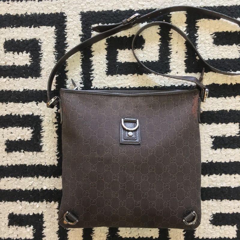 Gently used Gucci crossbody. Dark brown Gucci GG canvas with dark brown leather detailing and silver hardware. Come signs of use (shown in photos). Strap in great condition, and adjustable. Gorgeous staple for your closet! Retail approx: $1,800