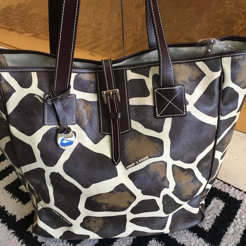 GENTLY USED Dooney & Bourke tote bag. Classic Dooney & Bourke giraffe print leather with brown leather strap and detail. Some interior markings (shown in photos), but overall like new! Retail approx: $398