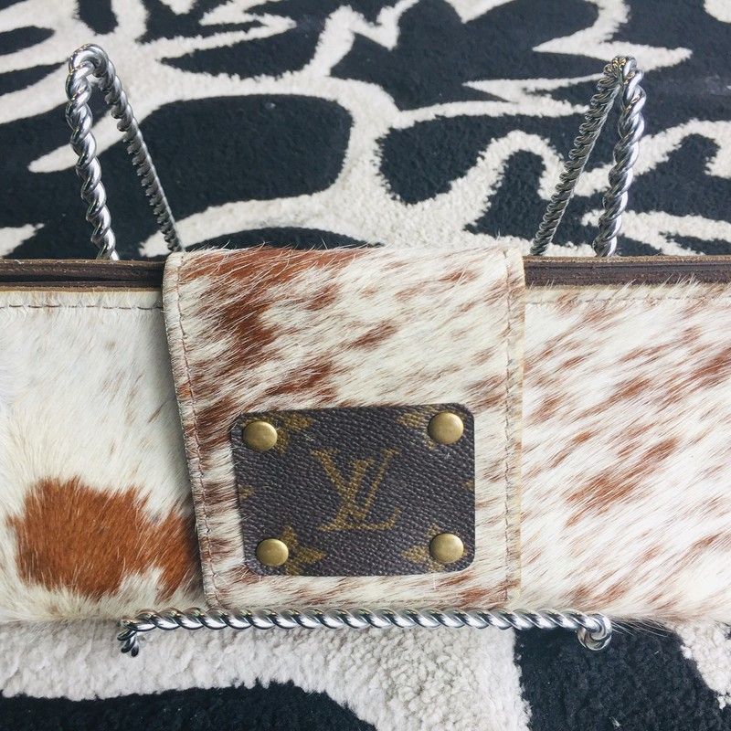 HANDMADE Louis Vuitton Clutch made of leather and cow hide. Great for casual and formal wear! Versitile!! This product is made from upcycled Louis Vuitton bags. Custom order only! If purchased, this item will be handmade and shipped just for you! (Delivery may take 4-6 weeks.)