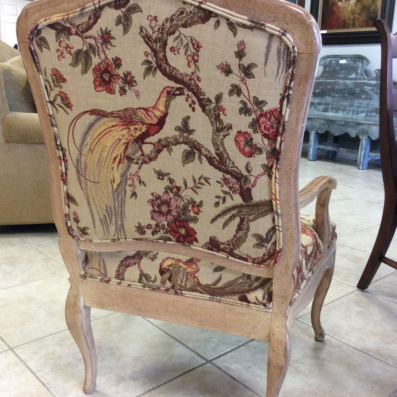 Classic and elegant, and so French! Ther frame has been painted and distressed giving it that weathered, vintagy look. Upholstered with a linen peacock print, full of vibrant colors.