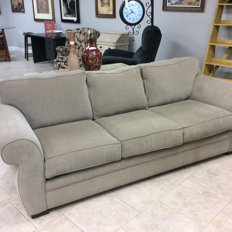This is a lovely sofa originally from Macy's. It features a taupe colored upholstery and is contemporary in style but neutral enough to fit into many decorative styles. Great condition!