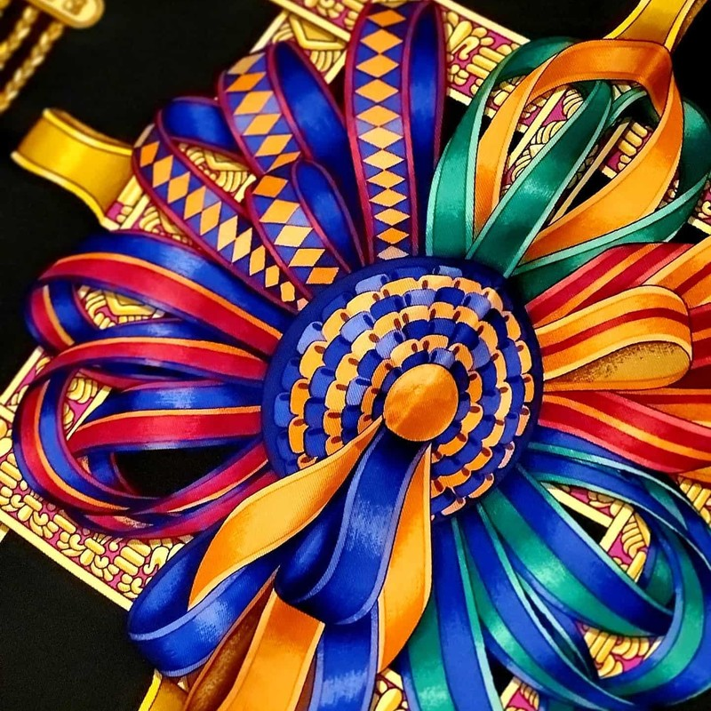 "LIKE NEW Hermès Scarf. Black, gold, and multicolor silk. Ribbon styling. Has ""Les Rubans Du Cheval"" printed. No signs of use. Don't miss this gorgeous scarf, perfect for any occasion!"
