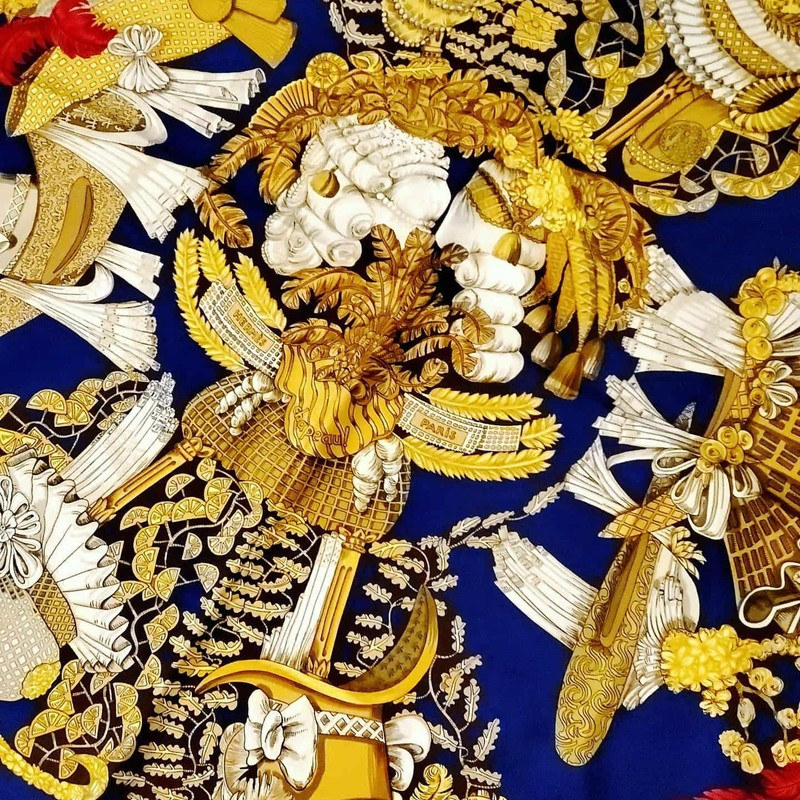 "GORGEOUS Hermès Scarf. Blue, red, gold, and white silk. Roman styling. Has ""Chapeau!"" printed. No signs of use, like new."