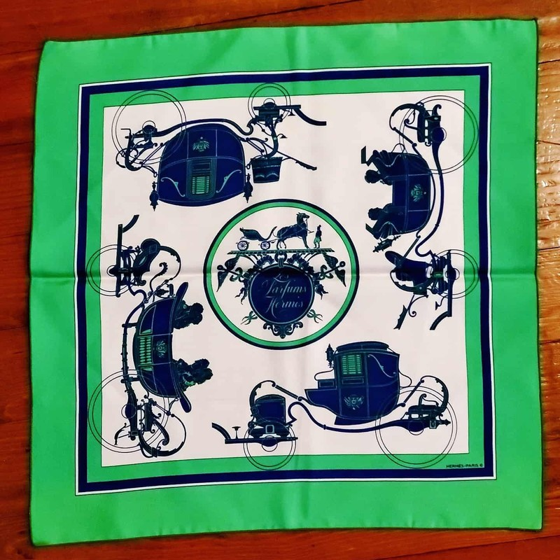 "PERFECT Hermès Scarf. Green, navy, and white silk. Has ""Les Parfums Hermes"" printed. No signs of use, no staining. Perfect for anyone!"