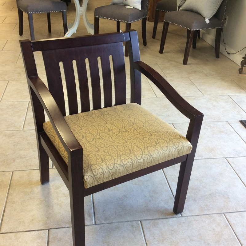 This very nice arm chair is made by INDIANA DESK COMPANY. It features clean, simple lines and includes an upholstered seat. Well-built and solid, it features a rich, mahogany finish. Very good condition. Come by and take a look!