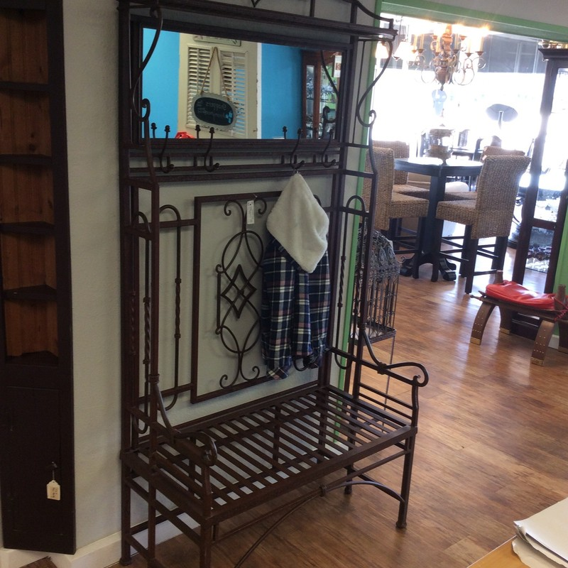 This beauty just came in and is a staff favorite! Constructed of iron - it is solid and well-made. Larger than most hall trees, it needs a good size space. Full of personality and old world charm it features a shelf at the very top, a mirror, 4 large hooks and a bench that would easily seat two. Really, really nice....