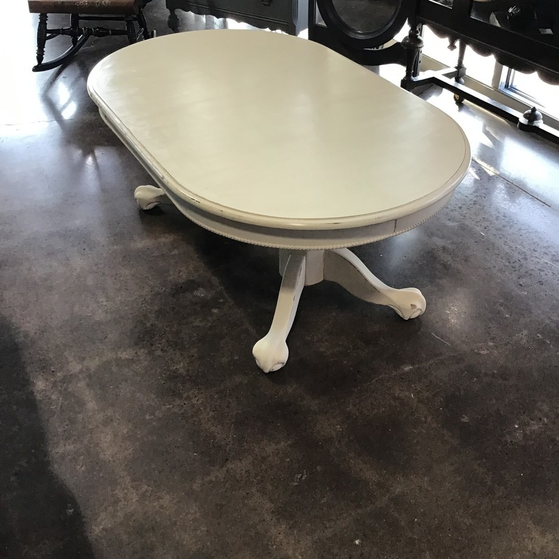 "This oval coffee table has been updated with Country Chic's Cheesecake paint, lightly distressed and the top has been protected with polyurethane. Perfect neutral piece for in front of your sofa, loveseat or set of chairs.<br /> Dimensions are 50"" x 30"" x 20"""