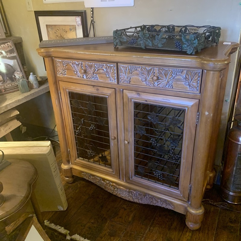 "Solid Wood Wine Cabinet. Great Condition. Has optional glass shelving. 45""W x 19""D x 42""H"