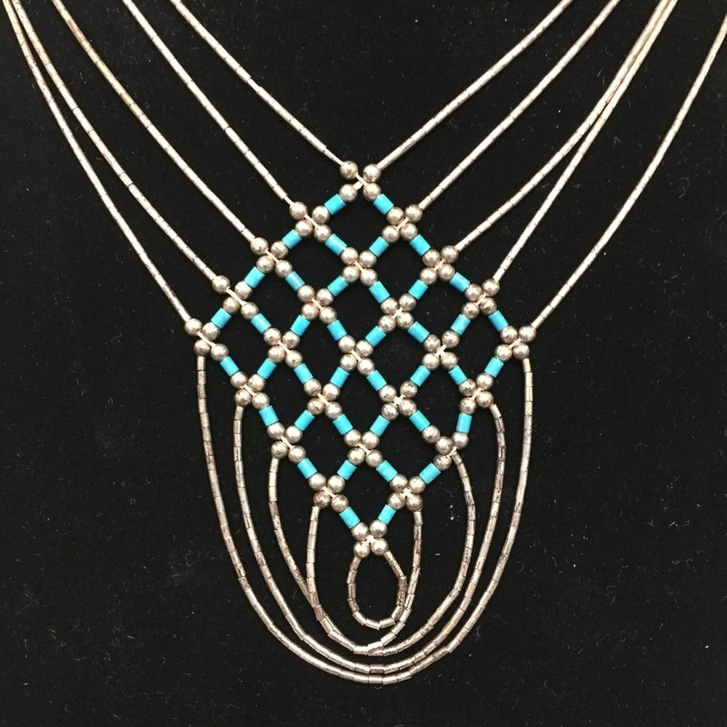This is a beautiful vintage 5 strand liquid silver turquoise necklace. Please note: I do not polish vintage silver.