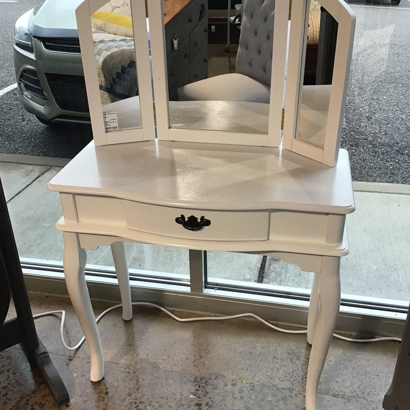 "This small white vanity is perfect for any young lady in your life! It has a center drawer for storage and tri-fold mirror.<br /> Dimensions are 32"" x 16"" x 50"""