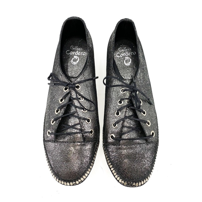 * SALE * Originally $375 NOW $187<br /> <br /> - Calleen Cordero black with silver glitter sneaker<br /> - Lace up<br /> - Size 9.5