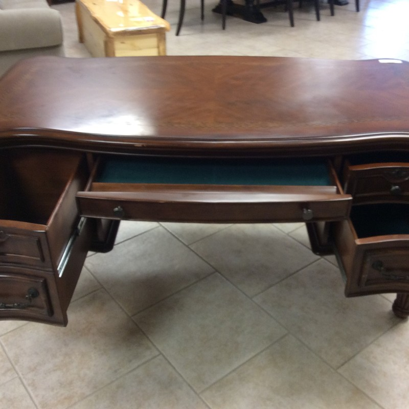 BARGAIN ALERT!! This handsome desk shows some signs of wear on the top, hence the lower than average price. It is solid wood with a walnut finish and has attractive patterned wood inlays. One of the drawers will hold hanging files, too. Only $395!