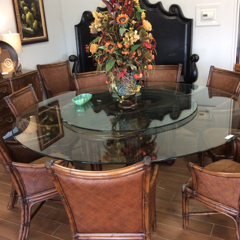 BARGAIN ALERT!!! This dining room table with 10, yes   TEN, chairs is stunning! From Thomasville, it's from the Ernest Hemingway Collection. Since it's debut ten yars ago, this collection has gained legenday status. The table features a gorgeous double pedestal base with a dark wood finish. The table top is glass with a built in glass Lazy Susan. The chairs are equally lovely, all armed with a woven seatback and an upholstered seat in a brown and black animal print. All of that for only $1295!!!!!