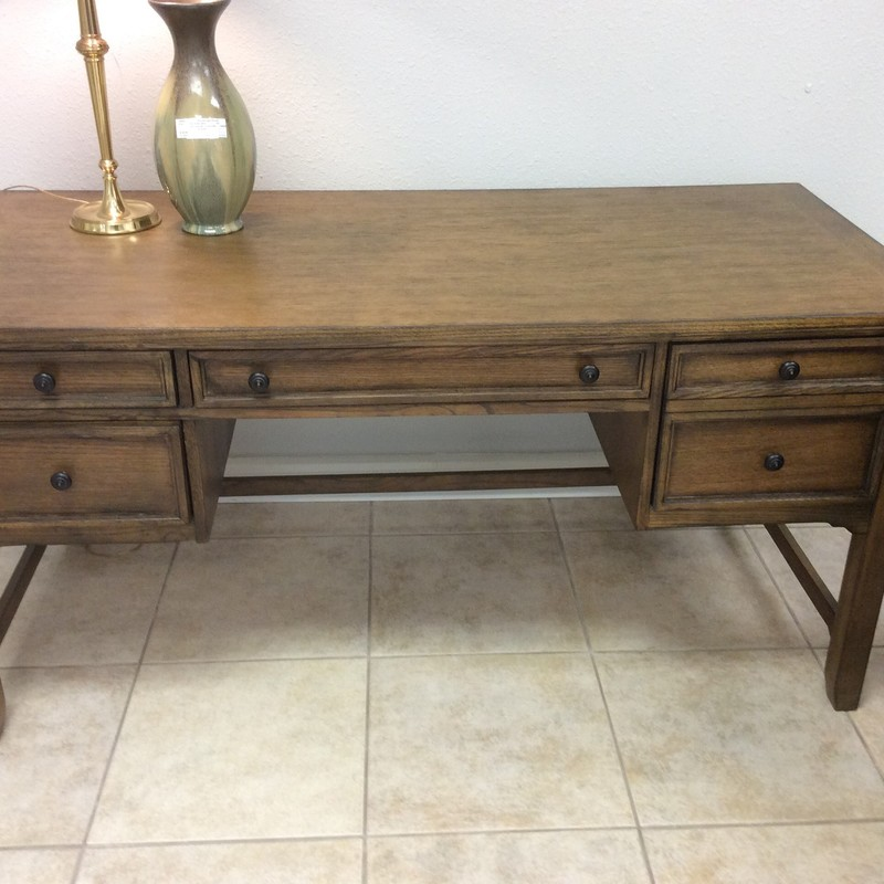 BARGAIN ALERT!!! This handsome duo is by WYNWOOD. Both pieces feature solid oak construction and have a dark stained finish. The desk has 4 drawers: 1 is a keyboard drawer, 1 is a lateral file drawer, and 2 are partitioned office supply drawers. The printer table has a large lower drawer this is also a lateral hanging file drawer.