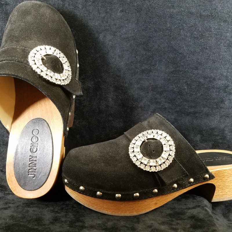 JIMMY CHOO CLOGS<br /> Size: 37.5<br /> NEW COST IS $486<br /> BLACK SUEDE<br /> WITH BROWN HEEL<br /> MAYBE WORN ONCE