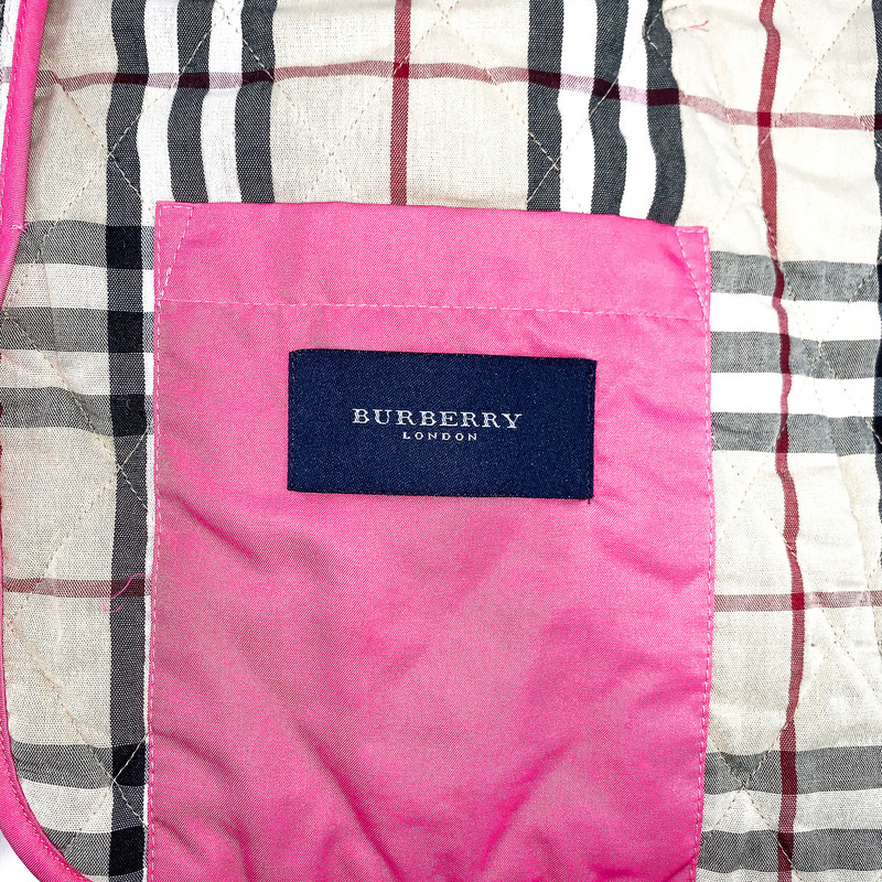 - Burberry bright pink quilted jacket for rain or spring time<br /> - Size small<br /> <br /> MEASUREMENTS:<br /> Chest: 38 in<br /> Waist: 38 in<br /> Arms: 22 in<br /> Full: 30 in