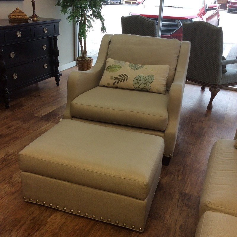 This is a very nice set by Sherrill! The chair, over-sized and over-stuffed, it's super comfy - one to spread out on! Upholstered in a thick, cotton blend in a neutral beige with a bright, bold nailhead trim. It includes a matching ottoman. The ottoman sits on casters making for super easy portability! Come by and take a look!
