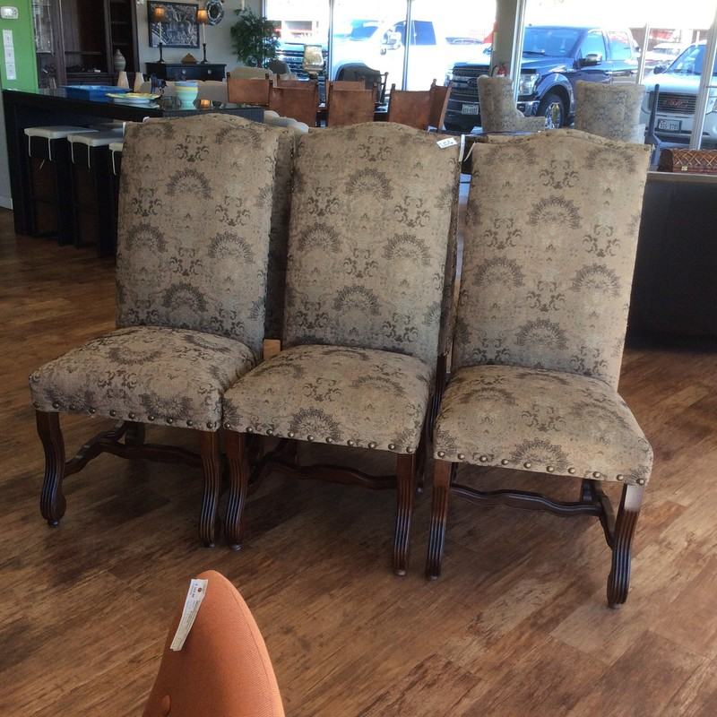 These elegant looking dining chairs are in fabulous condition. Large and comfy, they feature lovely upholstery in soft, earthy colors. They all have lovely nailhead accents, as well. Only $595 for all 6!