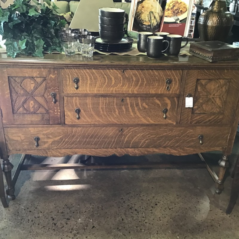 Absolutely gorgeous tiger oak buffet/madia stand.  This piece had to have been refinished to be in such great shape.  Two medium drawers in the middle with one large drawer running across the length of the piece down below.  Two door open for additional storage.  A beautiful piece that won't last long.<br /> DImensions: 60x23x38