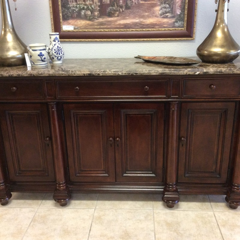 This THOMASVILLE buffet is in excellent condition. In fact, on the outside, it looks brand new! There are 3 felt-lined drawers up top, the center one of which is set up for flatware. Below, there are cabinet doors that reveal LOTS of storage space. To top it all off, there is a gorgeous piece of finished granite in varying shades of brown.