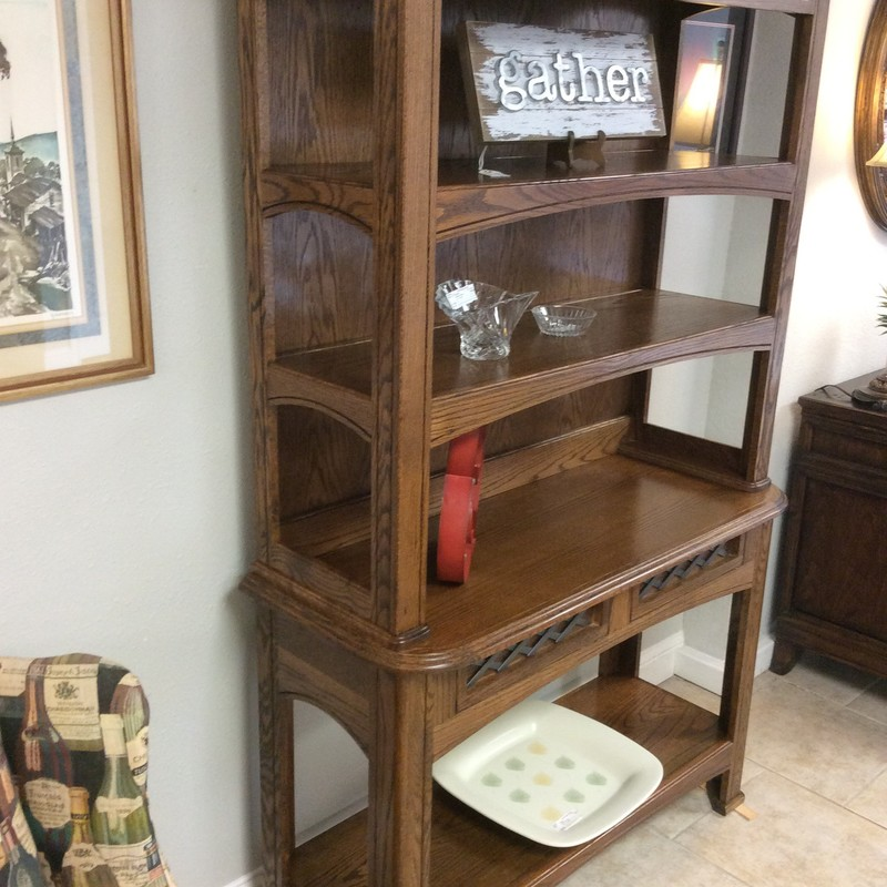 This very nice oak buffet/hutch features a dark wood finish, 4 shelves and 2 drawers with dovetail jointing. The top and the 2 drawers have a decorative metallic trim. It's in very good condition and priced well.