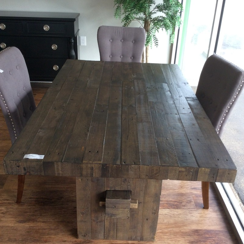 This look is ever so popular, the plank style dining room table! Nice size too, not too large - perfect fit for a smaller space or small dining room. Although no chairs are included, 4 fit nicely around it. It features a dark wood finish and distressing. Fan of the farmhouse/rustic look? This table is perfect! Come by and take a look!