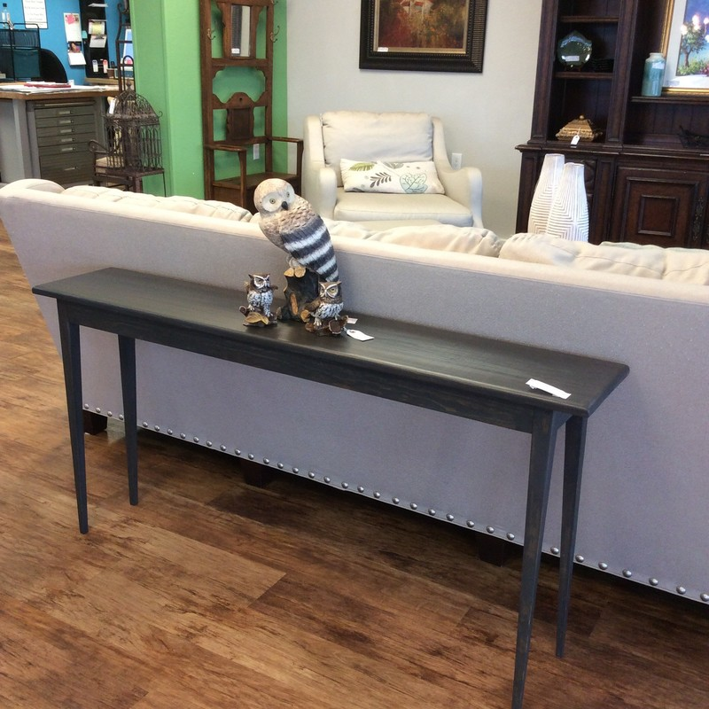 This custom-made sofa table is by our own Greg Watson! Contemporary in design, it features smooth, clean lines and has been painted a slate gray with subtle brown highlights. It's a lovely piece of woodwork.