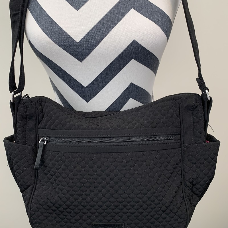 VeraBradley On The Go<br /> Size: 9h/11w<br /> Color: Black with floral interior<br /> Zip top closure with roomy main interior, a zip-up inside pocket and 2 side pouch pockets<br /> Exterior Zip-up pocket and 2 side pockets<br /> Adjustable crossbody strap