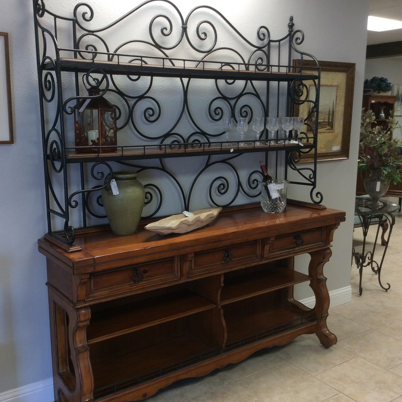 "This bakers rack is a gorgeous combination of pine and metal! Large at 72"" in width and 86"" in height, this is made for a large room. Although it is truly a bakers rack I can see this used for many things - it's a multi-tasker! The pine is gorgeous and the metal rack features an endless display of scrollwork. And storage opportunities? It's almost endless - 3 drawers with dovetail jointing, 2-tiered shelving at the bottom and wide shelves at the top that seem to go on forever. Don't know the brand but you know quality craftsmanship when you see it! This won't be here long, it's also priced well!"
