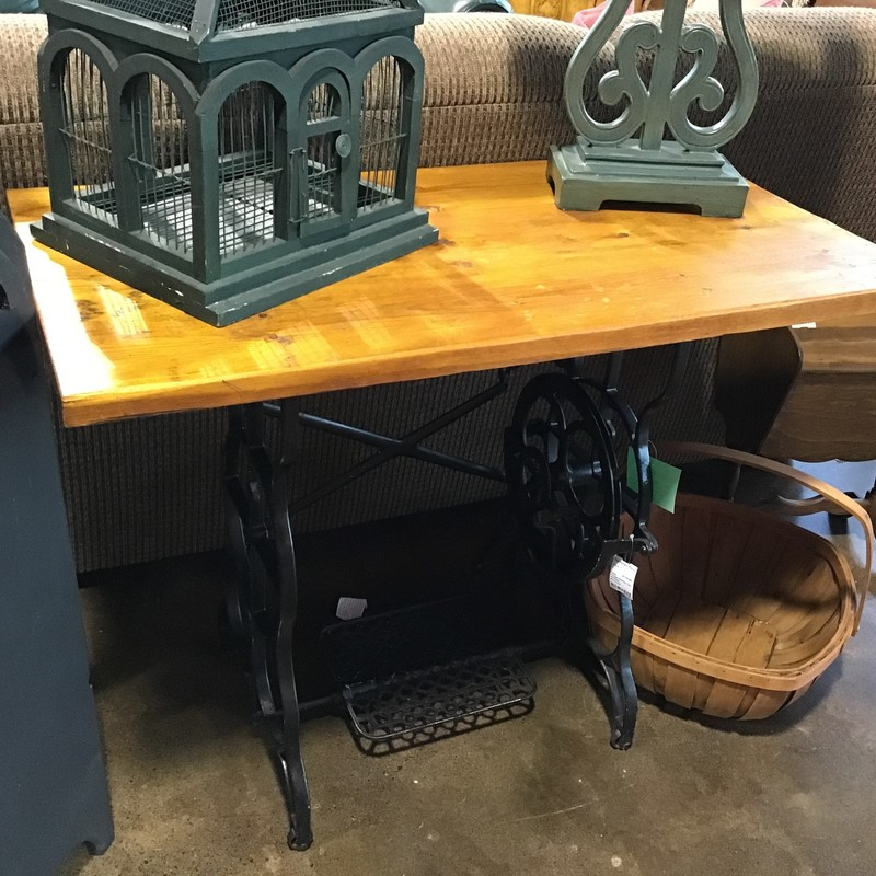 "This cool table was hand-made using the base from a vintage sewing machine and the top was made from wooden planks. Super cool piece for your home!<br /> Dimensions are 39-1/2"" x 20-1/2"" x 30"""