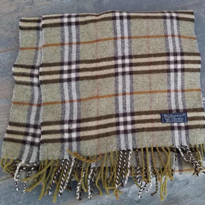 "BURBERRY VINTAGE SCARF<br /> RARE GREEN<br /> 73"" X 12"" WITH 2.5"" FRINGE ON BOTH ENDS<br /> ONE SMALL STAIN - SEE PICTURE"