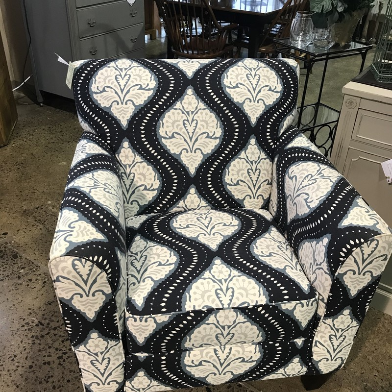 When style meets comfort, it's a beautiful thing. This La-Z-Boy Stationary Chair combines a streamlined look with subtle details to complement today's casual decor. It features an inviting box seat, welt trim, slightly flared arms and decorative tapered wood legs.  Featuring a modern parttern in navy and slate blue and highlighted with cream and grey, this comfy chair is a great addition to any room.<br /> <br /> Dimensions: 34x34x35