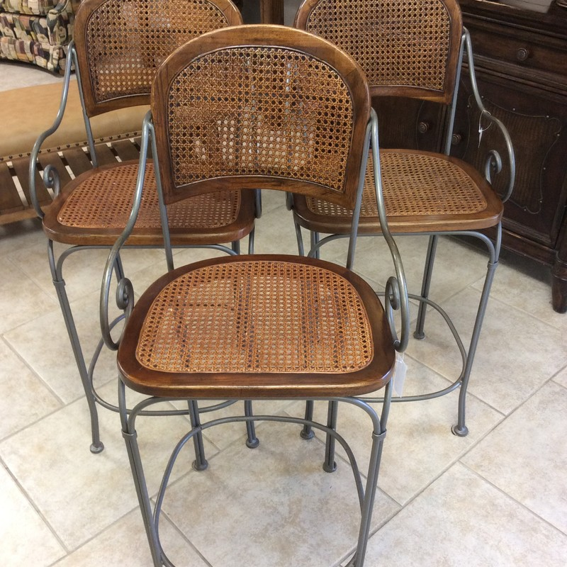 This is a darling little set of counter height bar chairs. The chair frames are heavy iron with a pewter finish and have foot rest bars. Both the seats and the seat backs are wood-framed pieces of beautifully handwoven caning.