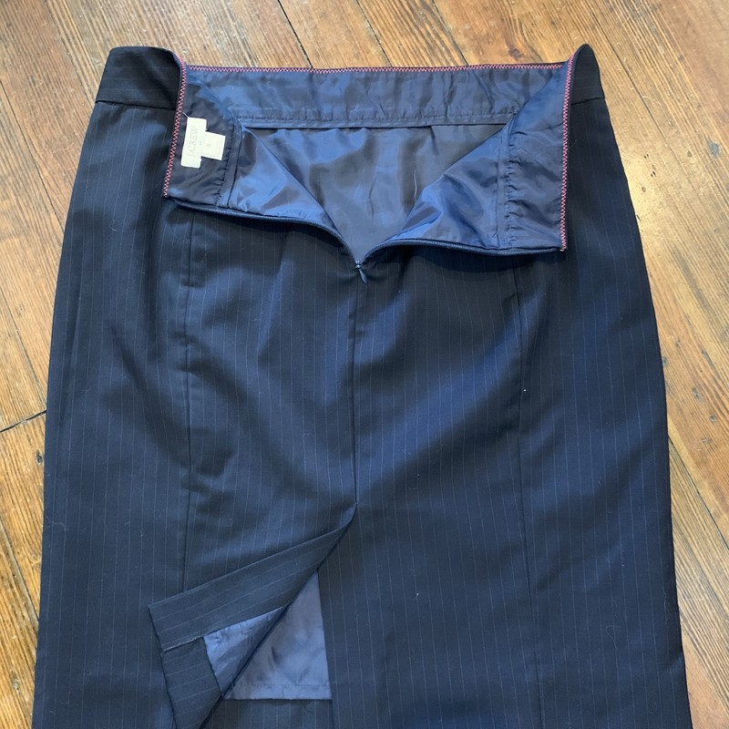 J.Crew Pin Stripe Pencil<br /> J.Crew Factory<br /> 99% Wool 1% Other, Fully lined 100% Polyester<br /> Size: 8<br /> Color: Black w/ Blue Pinstripe<br /> Small front slit pocket on Right waist/hip, Back zip, Back slit