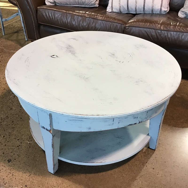 "WOW!  What a beautifully painted table done in Country Chic Elegance.  Elegance can best be described as a beachy blue.  This was painted over a black and the black and natural wood tone was pulled through during distressing and was then clear waxed.<br /> <br /> Dimensions:  36"" x 36"" x 18"""