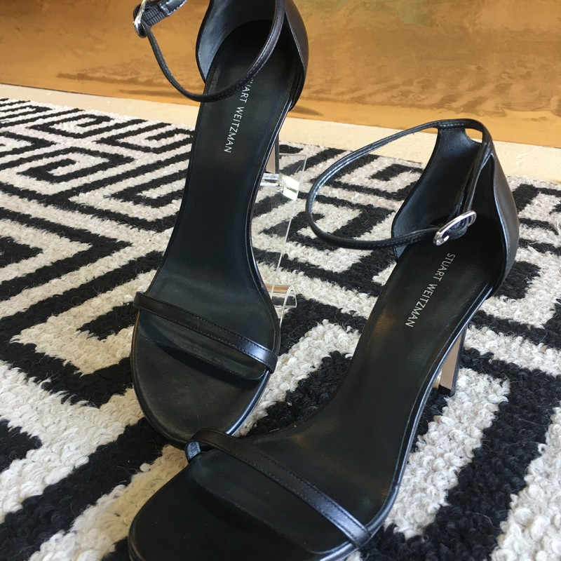 "LIKE NEW, Stuart Weitzman ""Nudist"" heel. Black leather with silver hardware on strap. 4.15 inch stiletto heel. Very few scuffs on outer sole from slight use, but overall looks brand new. Size 9. Retail: $398, still available at StuartWeitzman.com"