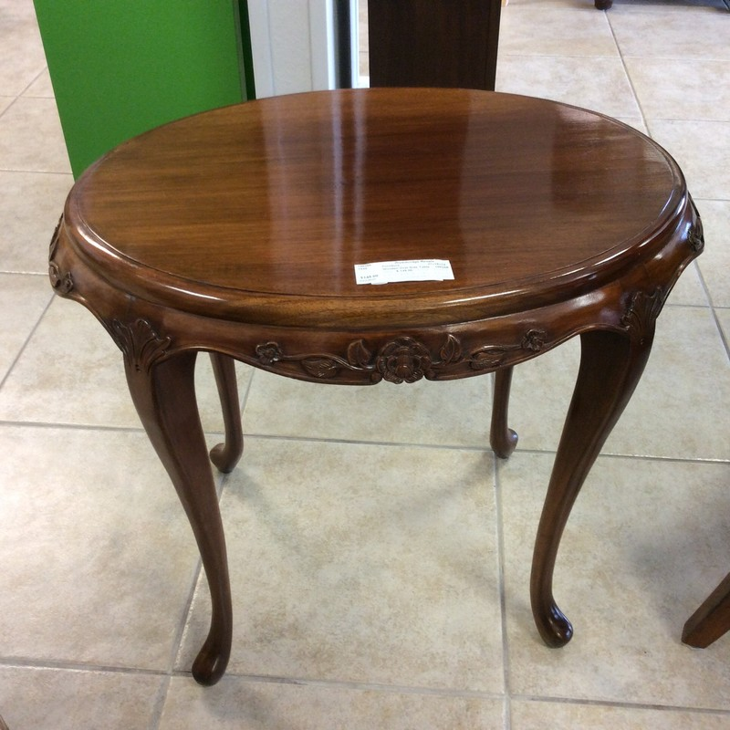 This oval shaped side table is on the smaller side, feminine and has a vintagy look and feel to it. It features detailed woodworking reflected in a delicate floral/leaf  pattern and slim, curvy legs. Good condition and priced well!