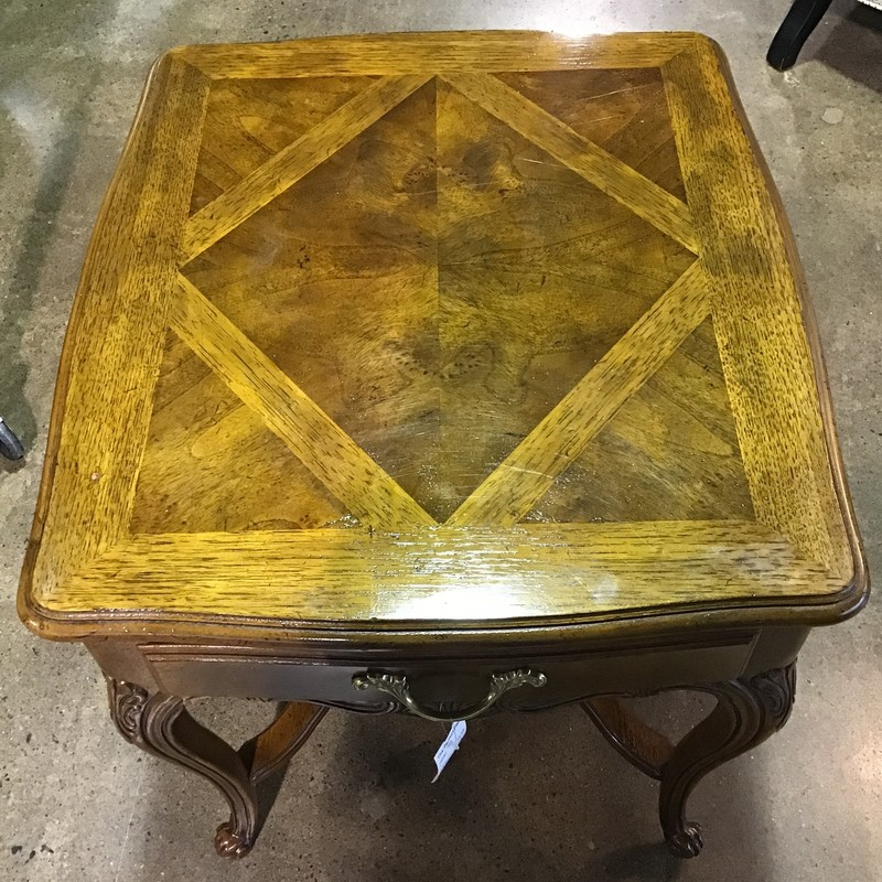 "This pretty end table comes from Heritage Furniture's Old Continent collection. It has a large surface, perfect for a lamp, floral and picture frames! It would be great next to a sofa or chair or even as a bedside table! There is even a small top drawer perfect for remotes or a book!<br /> Dimensions are 23-1/2"" x 26"" x 25"""
