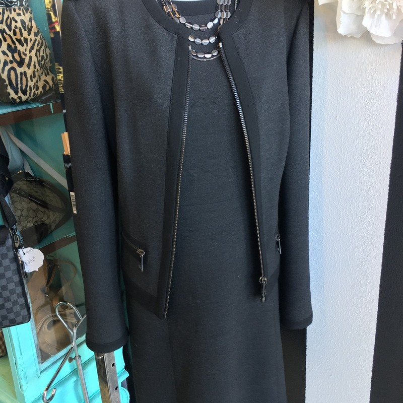 LIKE NEW Burberry 2 piece dress and jacket. Dark charcoal grey with black detailing and ash silver hardware. 2 useable zipper pockets in jacket. No signs of use, looks like it just came from Neiman Marcus. Size 10. Retail: $1,650.00