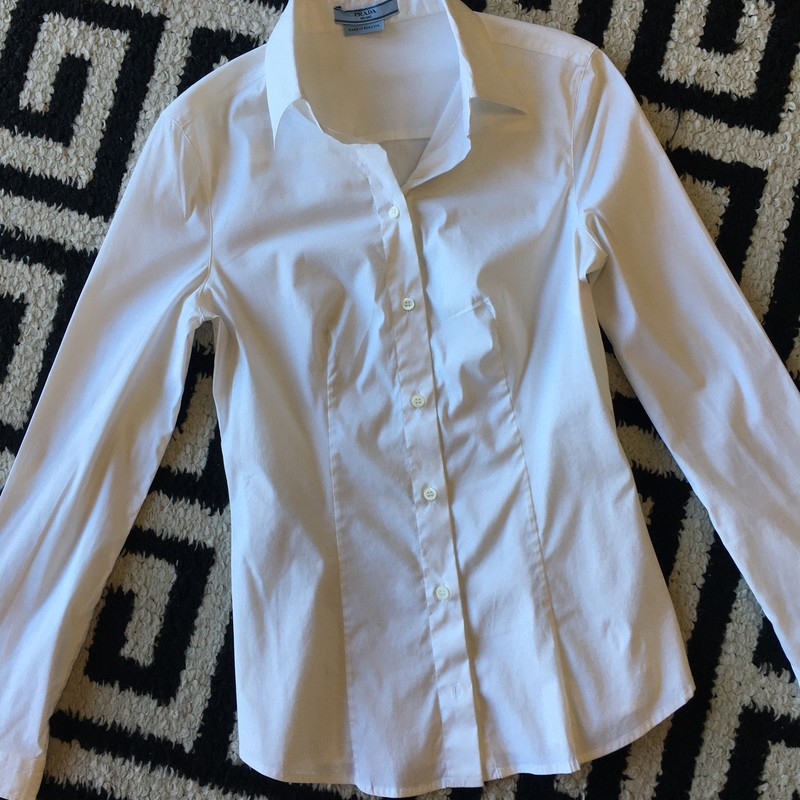 LIKE NEW Prada button up blouse. White cotton and nylon fabric. Zero signs of use, no tears, stains, or missing buttons. Made in Romania. Size 8. Retail: $980