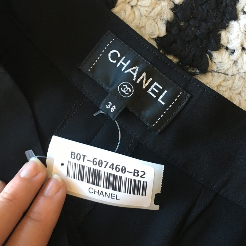 LIKE NEW Chanel silk slacks. Black silk. Has CC charm on front of pants. No signs of use, zero scuffs, tears, or missing buttons. Size 6. Retail: $1,200.00